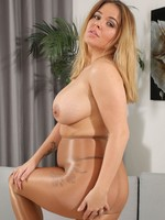 Busty Siobhan takes off her dress to showing off her beautiful assets before getting very playful with her tan glossy opaque pantyhose